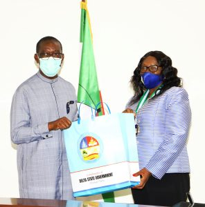 Delta Governor, Senator Dr. Ifeanyi Okowa (left),the President, Institute of Chartered Accountants of Nigeria (ICAN), Dame Joy Adewuyi, (right) receiving a souvenir from the Governor during a courtesy visit to the Governor in Government House ,Asaba. Tuesday.