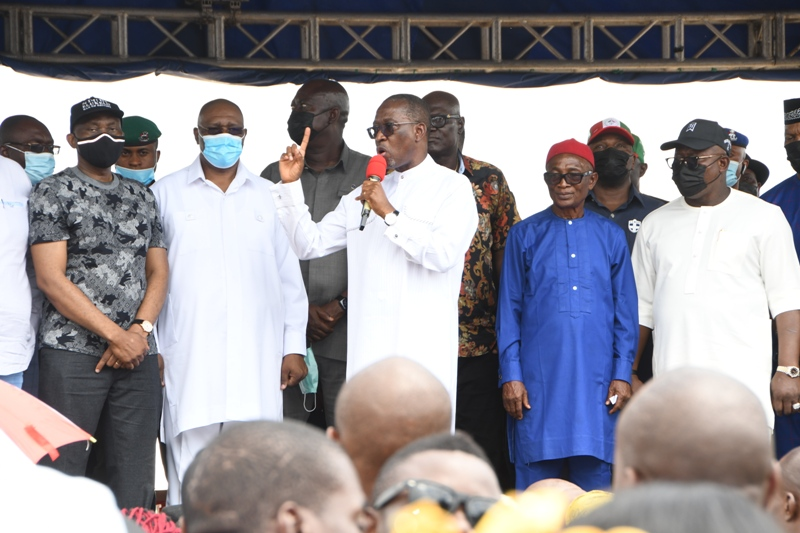 Delta Governor, Senator Dr. Ifeanyi Okowa (left) addressing the mammoth crowd of APC members who defected to the PDP in Aniocha/Oshimili Federal Constituency of the state, in Asaba on Thursday.