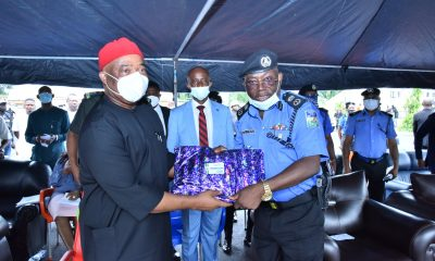 Imo State Governor, Senator Hope Uzodimma (2nd right) cuts the tape to Commission operational vans he donated to the Rapid Response Squad (RRS) of the Imo State Police Command. With him is Imo Commissioner of Police, Mr. Abutu Yaro (2nd left) and others when the Governor paid a Condolence visit to the Police Command Headquarters, Owerri on Tuesday